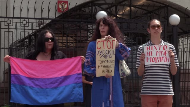 ukrainian lgbt activists hold a flag and placards reading 'nobody should be silent' and 'stop russian world homophobia hate war' during their rally... - homophobia stock videos and b-roll footage
