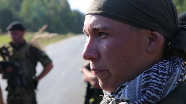 ukrainian military cadets answer questions from a reporter after successfully roadside ambushing members 1st battalion 503rd airborne regiment 173rd... - military exercise stock videos and b-roll footage