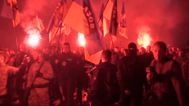 ukrainian nationalists and servicemen of the azov battalion demonstrate during the march marking the 72nd anniversary of the ukrainian insurgent army... - ウクライナ点の映像素材/bロール