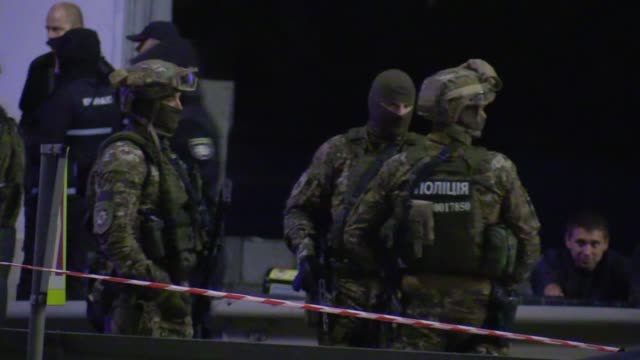 ukrainian police and members of ukrainian special forces take part at an operation for detain a man who was threatening to blow up a major bridge... - carbine stock videos and b-roll footage