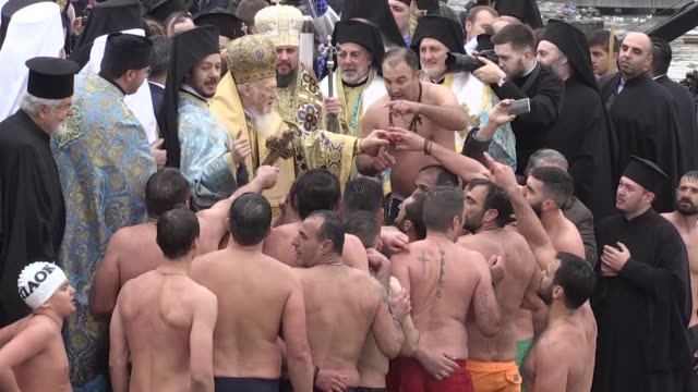 ukrainian president petro poroshenko his wife maryna poroshenko and fener greek orthodox patriarch bartholomew watch as dozens of orthodox men jump... - inlet stock videos and b-roll footage