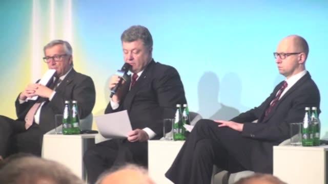 Ukrainian President Petro Poroshenko the President of the European Commission JeanClaude Juncker and Ukraine's Prime Minister Arseniy Yatsenyuk...