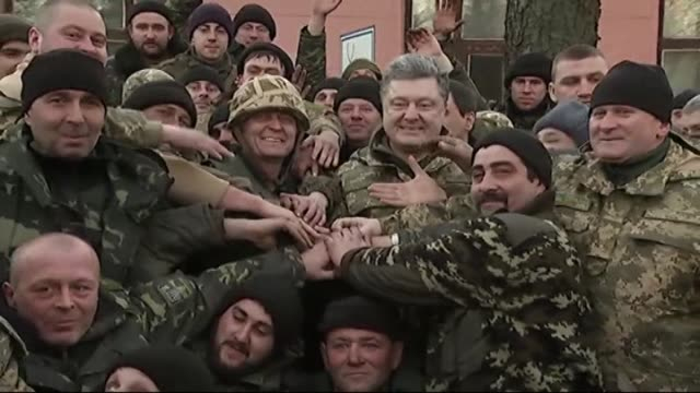 ukrainian president petro poroshenko visits troops withdrawn from debaltseve city of donetsk where the clashes continue between ukrainian army and... - waffenstillstand krieg stock-videos und b-roll-filmmaterial