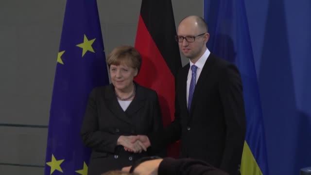 Ukrainian Prime Minister Arseniy Yatsenyuk and German Chancellor Angela Merkel attend a press conference following their meeting at the German...