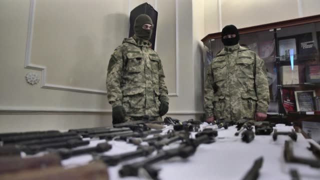ukrainian prosecutors and security services say they have uncovered a cache of weapons in kiev including kalashnikovs and a sniper rifle used by a... - weapon stock videos & royalty-free footage