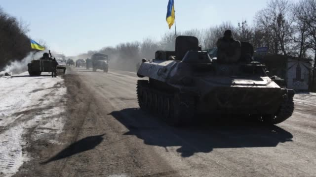 ukrainian troops retreat from the eastern ukrainian city of debaltseve in the donetsk region where the clashes between ukrainian army and pro-russian... - ceasefire stock videos & royalty-free footage