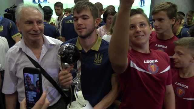 Ukrainian U20 national soccer team players and fans and supporters pose for a selfie with the FIFA U20 World Cup trophy during a meeting ceremony at...