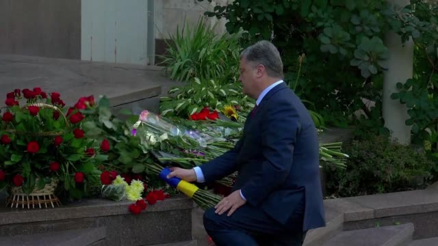 Ukrainians and President Poroshenko lay flowers in front of the French embassy in Kiev on Friday to pay tribute to the victims of the attack in Nice...