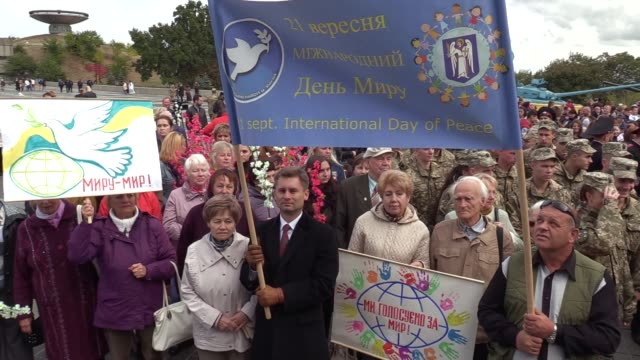 Ukrainians carry antiwar placardsas they take a part at a 'Peace March' at the museum of WWII in Kiev Ukraine 21 September 2016 The event is timed to...