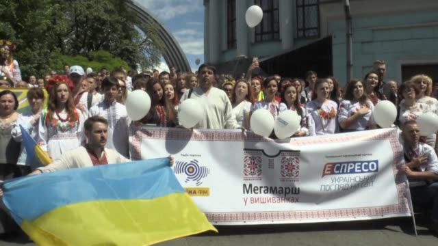 ukrainians hold a parade in kiev celebrating the vyshyvanka a traditional ukrainian shirt decorated with colourful embroidery - stickerei stock-videos und b-roll-filmmaterial