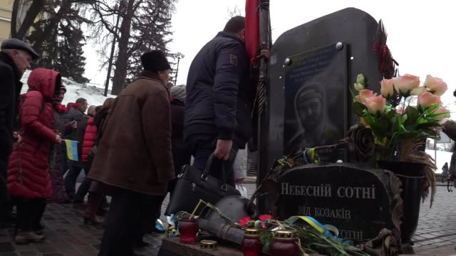 Ukrainians marchlays flowers and light candles to the memorial for Maidan activists or Heroes of the Heavenly Hundred who were killed on the Maidan...