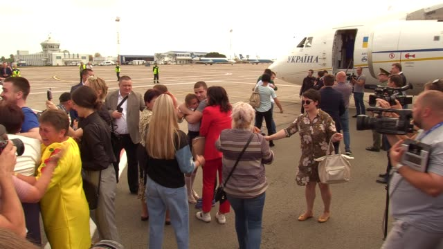 ukrainians who was jailed in russia hugs their relatives upon arrival during a welcoming ceremony after russiaukraine prisoners swap at the boryspil... - political prisoner stock videos & royalty-free footage