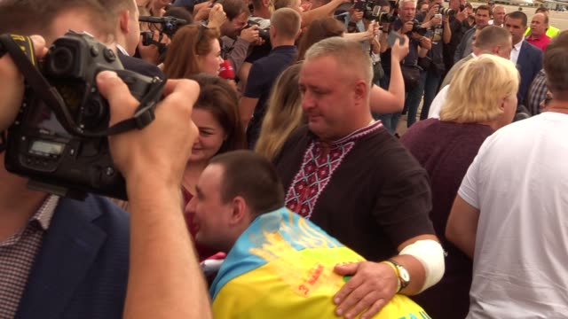 ukrainians who was jailed in russia seen with their relatives upon arrival during a welcoming ceremony after russiaukraine prisoners swap at the... - political prisoner stock videos & royalty-free footage