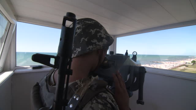 Ukranian soldiers keeping watch over a beach in Kherson situated close to Crimea