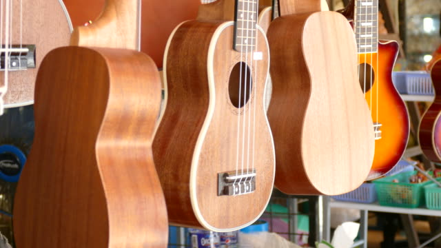 ukulele shop - guitar stock videos & royalty-free footage