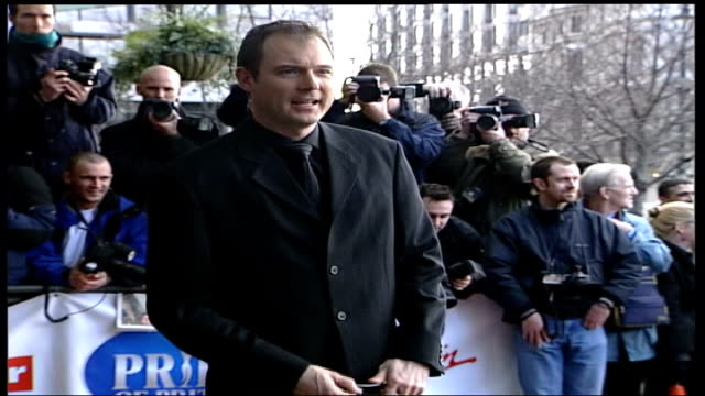 stockvideo's en b-roll-footage met man named lib ext john leslie posing for press before entering building - ulrika jonsson