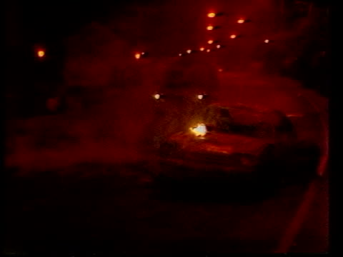 vídeos de stock e filmes b-roll de peter robinson: minimal entry; c) northern ireland: west belfast: ext / night burning car on road police vehicles on road cas ex eng via ulster:... - província do ulster