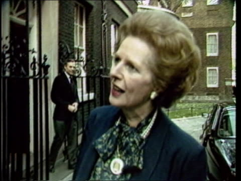 ulster shooting c4n england london downing street ms prime minister margaret thatcher out of no 10 towards car zoom as margaret thatcher comments sof... - downing street stock-videos und b-roll-filmmaterial
