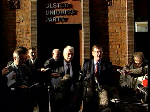Ulster unionists ITN NORTHERN IRELAND Belfast EXT David Trimble MP standing outside party headquarters with other Ulster Unionist politicians as...