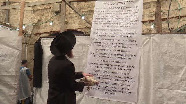 ultra orthodox jews in jerusalem took part wednesday in kapparot a customary ritual practiced on the eve of yom kippur which consists of swinging a... - jom kippur stock-videos und b-roll-filmmaterial