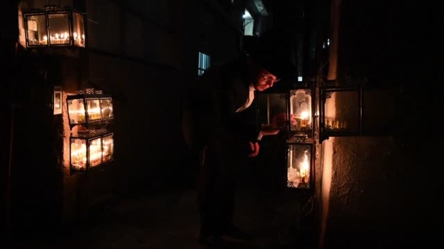 ultra orthodox jews light menorah candles outside their homes on hanukkah also known as the festival of lights a jewish holiday commemorating the... - biblical event stock videos & royalty-free footage