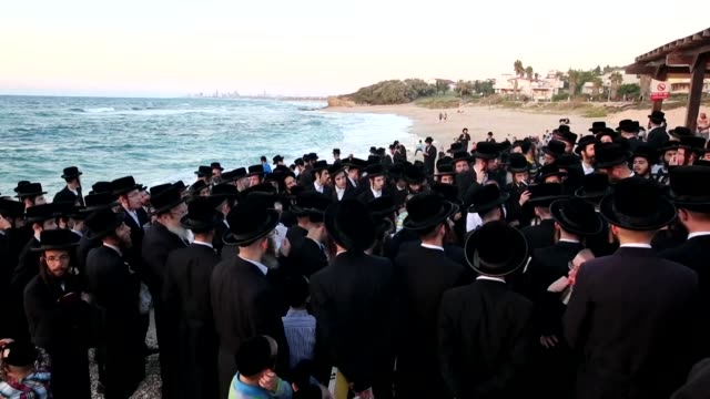 ultra orthodox jews performed tashlich thursday on a beach in palmahim near tel aviv a ritual during which believers cast their sins into the water... - jom kippur stock-videos und b-roll-filmmaterial