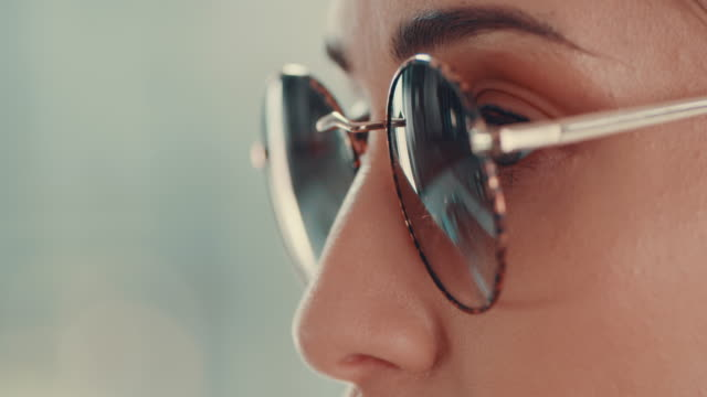 ultra stylish fashion for ultraviolet protection - sunglasses stock videos & royalty-free footage