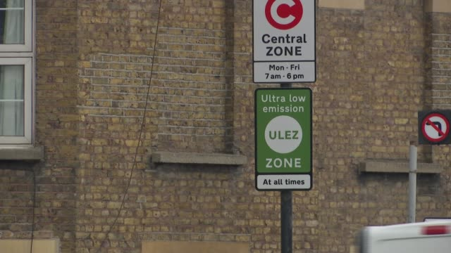 Ultralow emission zone comes into force in central London ENGLAND London EXT Various shots of traffic along congestion zone Congestion charging signs...