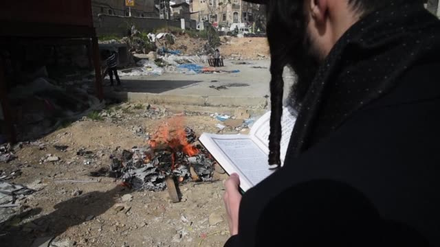 ultraorthodox jewish men burned leavened items as part of the biur chametz ritual in jerusalem monday final preparations before the start of the... - passover stock videos and b-roll footage