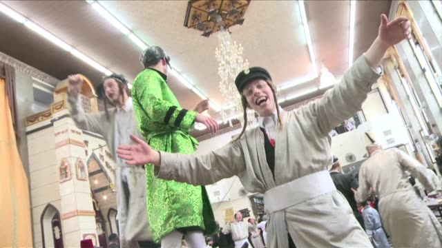 stockvideo's en b-roll-footage met ultraorthodox jews are celebrating purim a carnivallike holiday with parades and costume parties in which they commemorate the deliverance of the... - orthodox jodendom