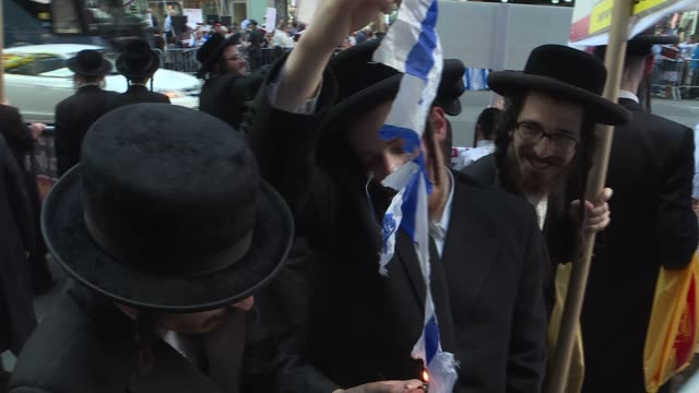 ultraorthodox jews hold a demonstration to support u.s. representative ilhan omar at 7th avenue near of the times square in new york, united states... - 7th avenue stock videos & royalty-free footage