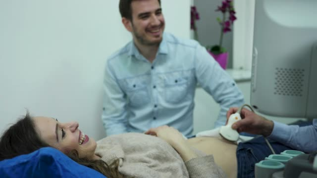 ultrasound examination in doctors office - ultrasound scan stock videos & royalty-free footage