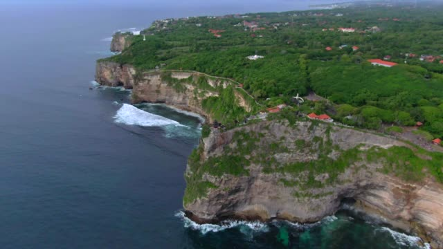 uluwatu temple and landscape / bali, indonesia - rock face stock videos & royalty-free footage