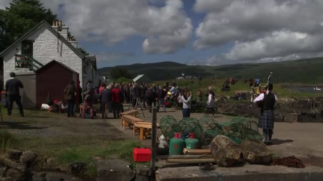 Inhabitants of small Scottish island celebrate becoming its owners SCOTLAND Inner Hebrides Ulva EXT People gathered to celebrate the purchase of the...