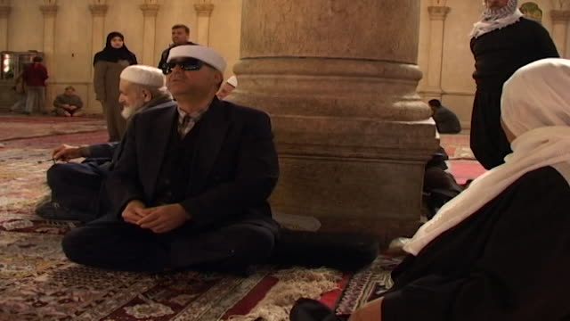 umayyad mosque mcu of a blind muslim worshipper in the mosque which is one of the largest and oldest in the world - worshipper stock videos & royalty-free footage