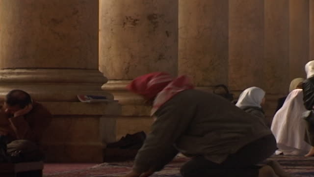 umayyad mosque mcu view of a worshipper prostrating in prayer the mosque is one of the largest and oldest in the world - worshipper stock videos & royalty-free footage