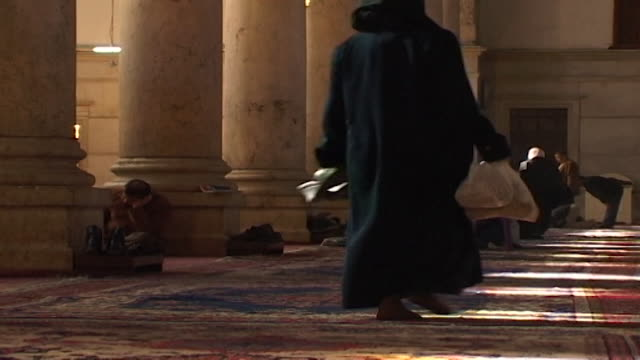 umayyad mosque view of a worshipper prostrating in prayer the mosque is one of the largest and oldest in the world - worshipper stock videos & royalty-free footage