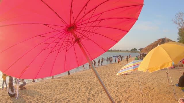 umbrella on tropical sunset beach - beach umbrella stock videos and b-roll footage