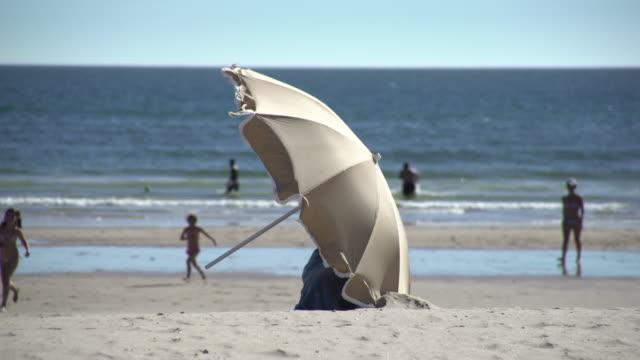 umbrella - beach umbrella stock videos and b-roll footage