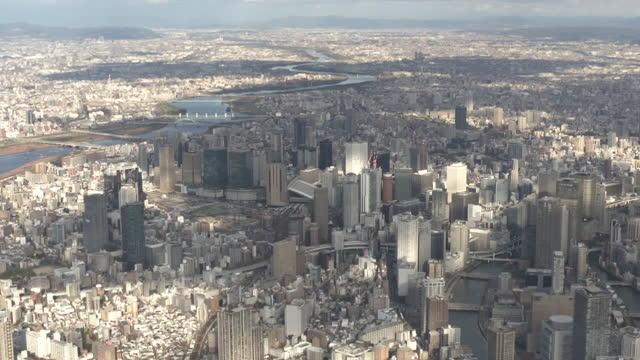aerial, ls, umeda and osaka station, japan - 大阪駅点の映像素材/bロール