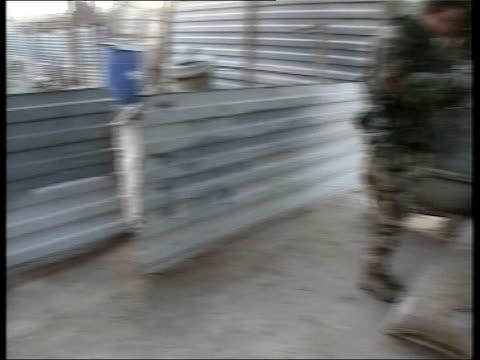 umm qasr ext british royal marines kicking down door and rushing into house in dawn raid to seize saddam hussein loyalists track int marines... - 英国海兵隊点の映像素材/bロール