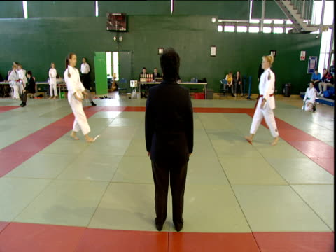umpire starts judo competition between two girls contestant is thrown london towers england - contestant stock-videos und b-roll-filmmaterial