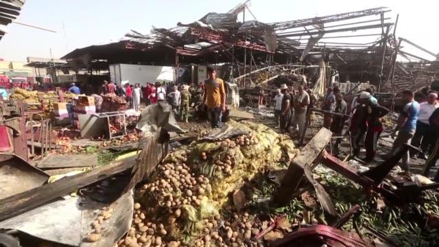 un atentado con camion bomba reivindicado por el grupo yihadista estado islamico dejo este jueves al menos 54 muertos y 100 heridos en el mercado de... - irak stock videos and b-roll footage
