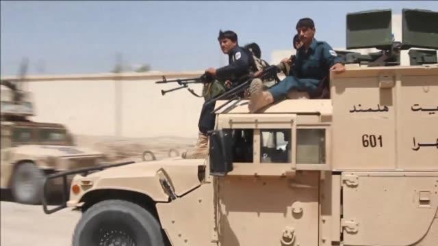 vídeos y material grabado en eventos de stock de un bombardeo estadounidense contra los talibanes acabo con la vida de dieciseis policías afganos alcanzados por error el viernes en el sur del pais... - ee.uu