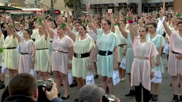 un centenar de evitas hombres y mujeres con mono y vestidos de color pastel tomaron el lunes la plaza frente al congreso argentino para evitar la... - mauricio macri stock videos and b-roll footage