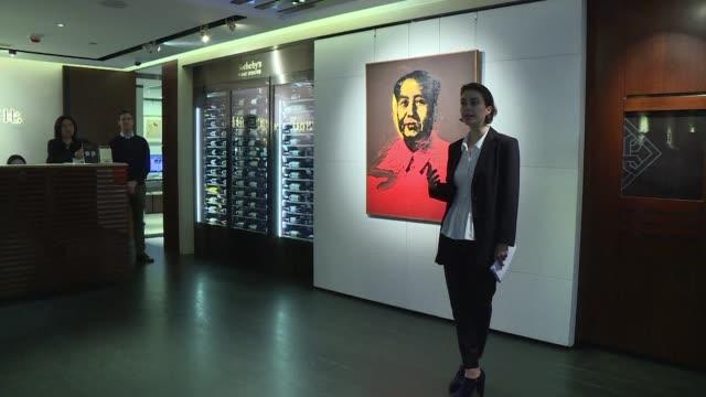 un retrato serigrafiado del dirigente chino mao zedong realizado en 1973 por andy warhol se vendio en subasta a 127 millones de dolares el domingo en... - sotheby's stock videos and b-roll footage