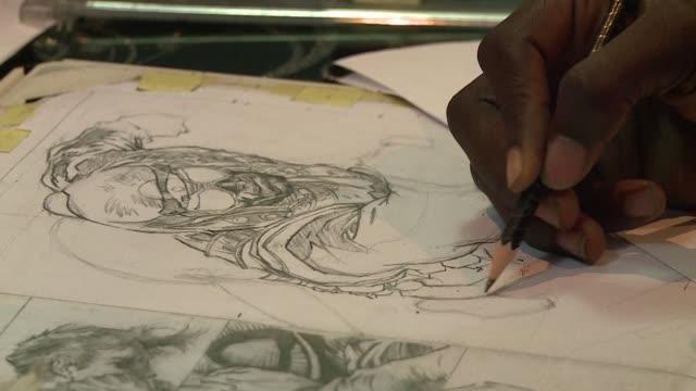 vídeos y material grabado en eventos de stock de una editorial de comic nigeriana ha creado superheroes que rivalizan con iron man batman o spiderman a diferencia de storm el superheroe de xmen con... - ee.uu