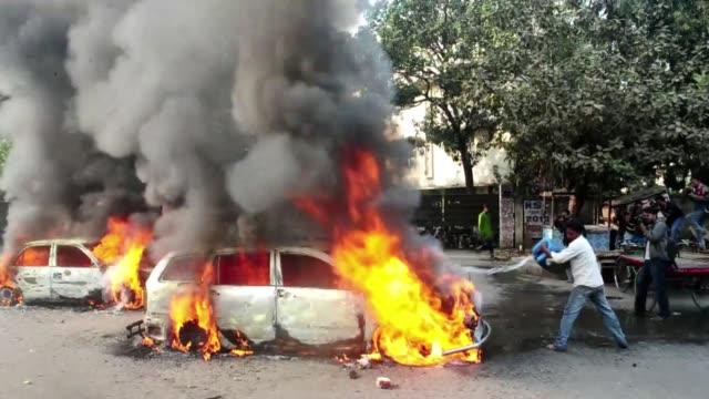 una ola de violencia se desato este viernes en bangladesh, tras la ejecucion de un jefe islamista considerado responsable de matanzas cometidas... - independence stock videos & royalty-free footage
