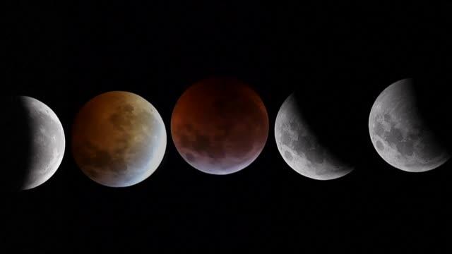 una serie de circunstancias celestes inusuales coincidieron el domingo por la noche para ocultar la luna que luego reaparecio vestida de un tenue... - astronomia stock videos & royalty-free footage