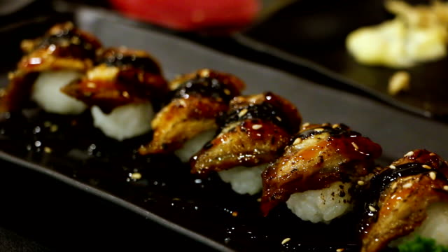 unagi sushi in the japanese restaurant, food is cooked from the chefs, very good, very tasty. - japanese food stock videos & royalty-free footage